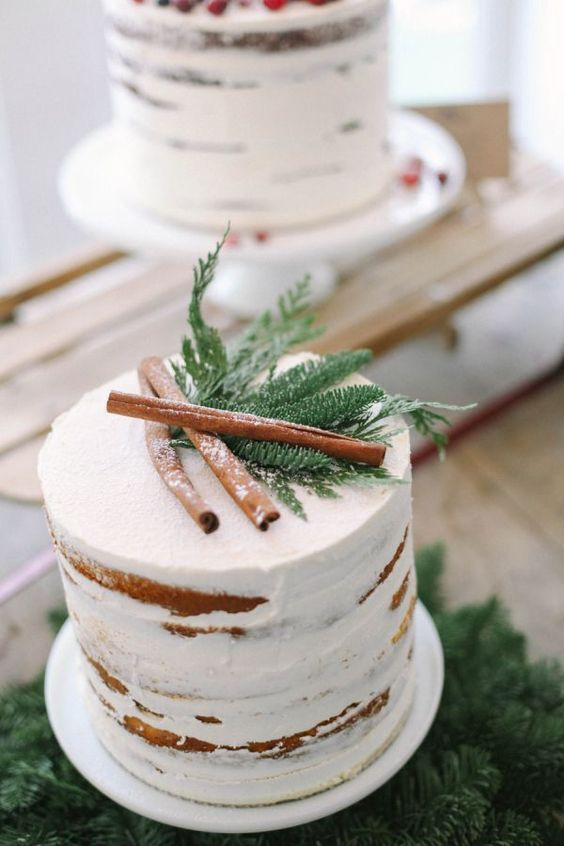 evergreens and cinnamon bark are an effortless and cool topper idea to pull off a rustic or woodland wedding theme