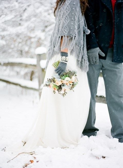 grey embellished gloves match the cable knit coverup of the bride making her look complete