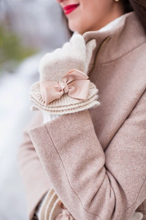 white knit gloves decorated with blush bows to match a blush coat for a cute vintage feel