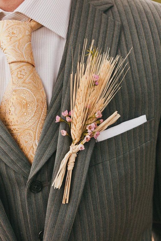 a white and pink bloom boutonniere is amazing for a rustic wedding in the fall or late summer