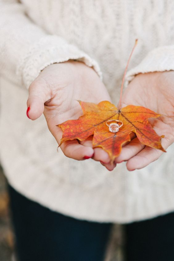 show off your engagement ring on a fall leaf if you got engaged in this beautiful season