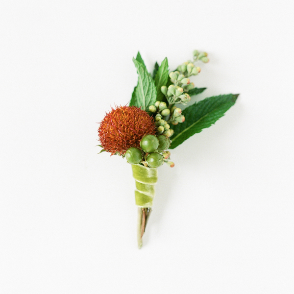 DIY non-floral boutonniere with herbs and berries (via www.oncewed.com)