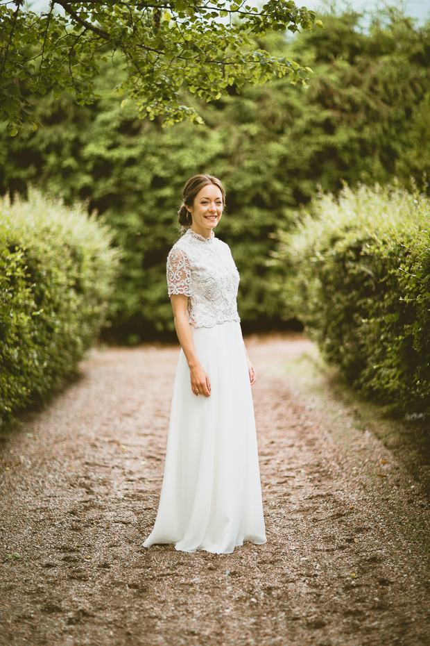 The bride was wearing a separate of a lace embellished top and a plain chiffon skirt
