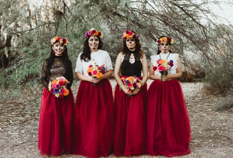 The bridesmaids were wearing layered red tulle skirts and white and black lace tops, plus bright floral crowns