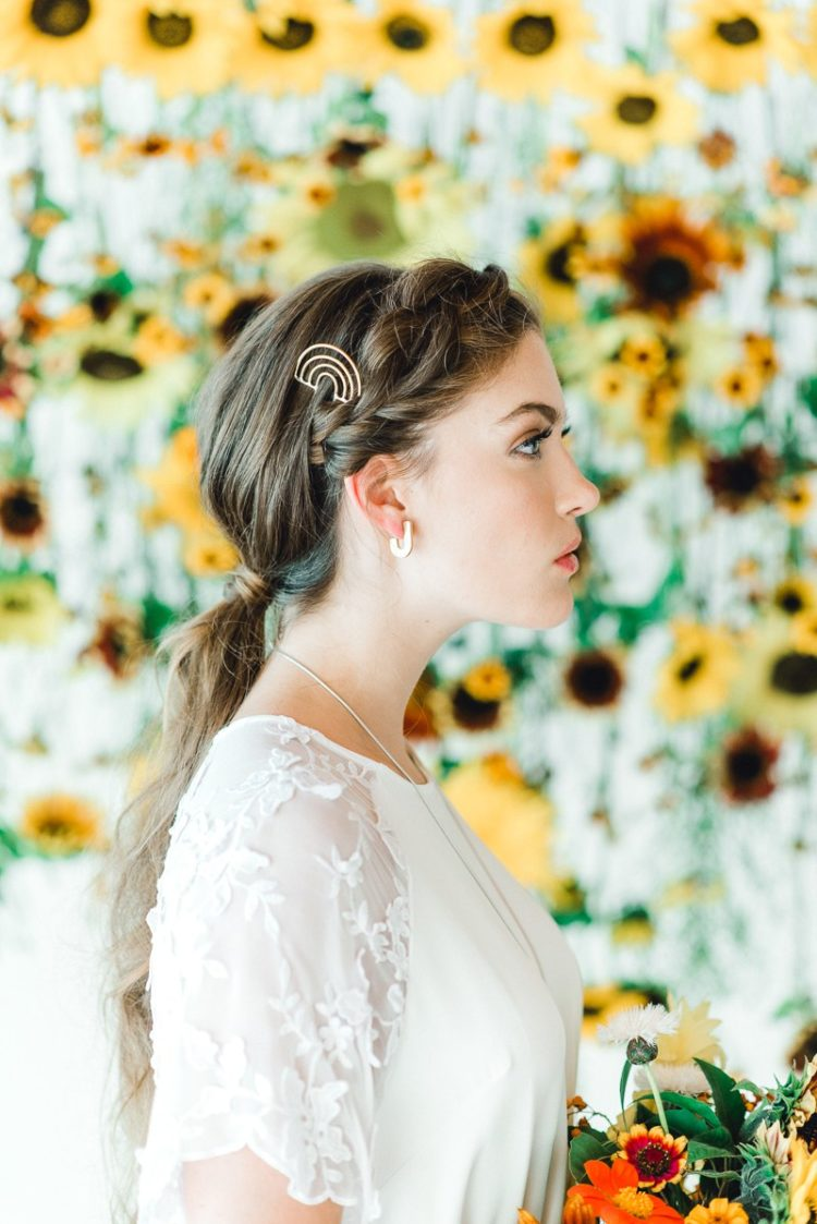 The first wedding hairstyle was with a braided halo and a low ponytail