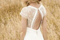 02 a boho wedding gown with a lace bodice and a cutout back on a button and a plain A-line skirt