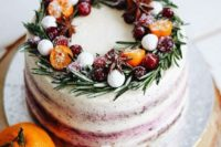 02 a buttercream wedding cake with citrus, berries and evergreens is a fresh take on traditional Christmassy cakes