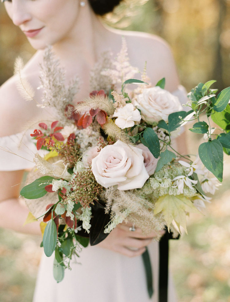 Her bouquet included both creamy hues and burgundy ones plus greenery and dried herbs