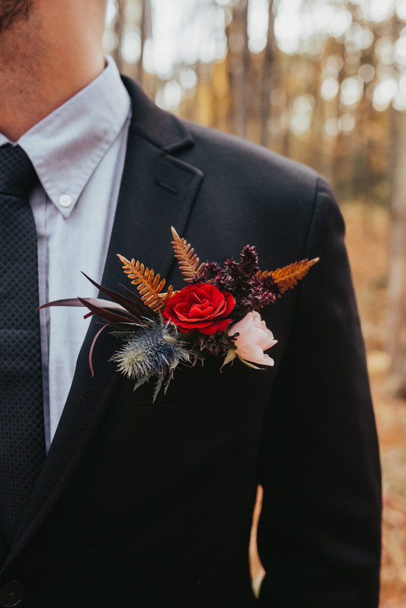The groom was rocking a classic black tux and a colorful floral boutonniere