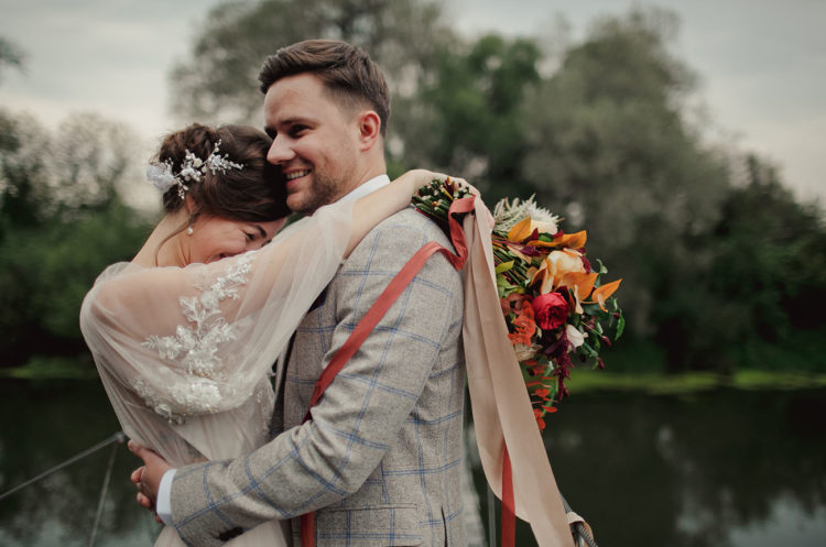 The groom was wearing a grey suit with a windowpane print, the bridal headpiece was a floral one