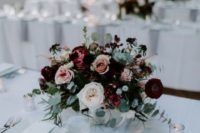 03 a bright and a bit moody winter floral centerpiece with burgundy, blush and white blooms and pale greenery