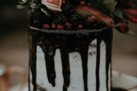 03 a chic naked drizzle wedding cake topped with berries and dark blooms and foliage for Christmas