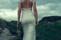 03 a fitting boho lace wedding dress with short sleeves and a geometrically cutout back