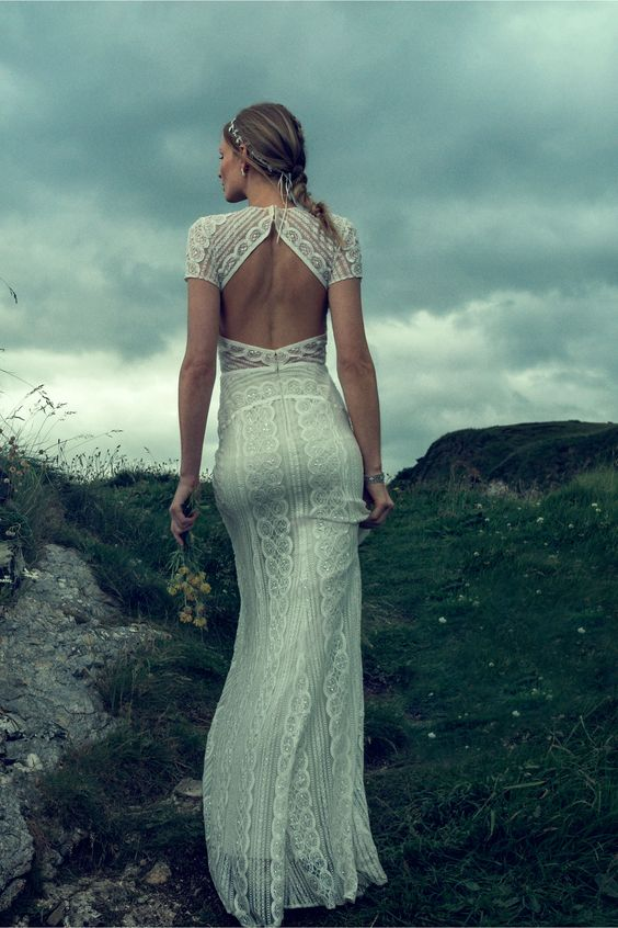 a fitting boho lace wedding dress with short sleeves and a geometrically cutout back