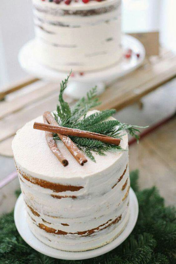 a naked wedding cake topped with evergreens and cinnamon sticks - you won't need more than that for a naturally beautiful look