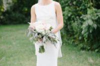 03 a sleeveless high neckline fitting wedding dress with a train plus a veil for create a chic modern bridal look