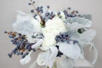03 this bouquet seems to be frozen with white blooms, berries and pale miller