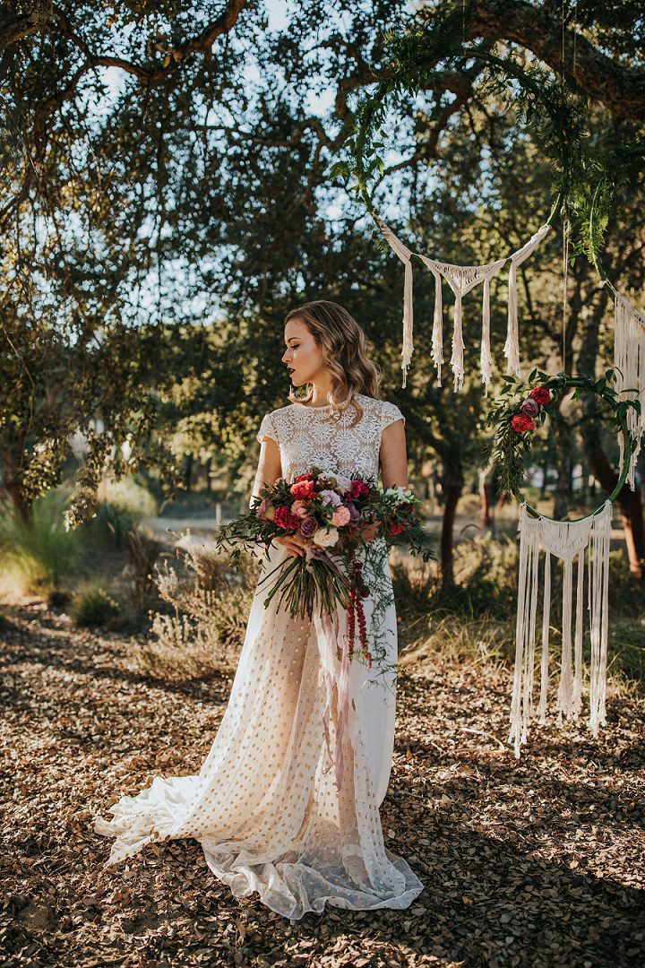 The bride was wearing an unusual wedding gown with a lace bodice and an embellished polka dot skirt with a train