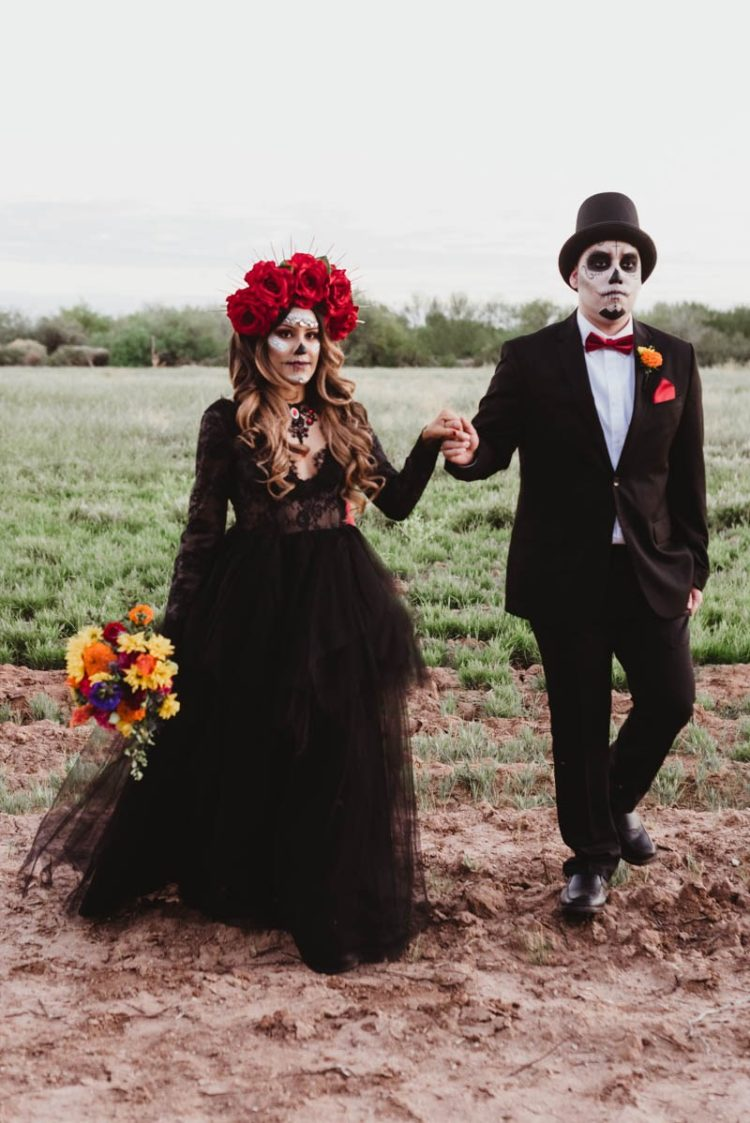 The groom was rocking a classic tux with a red bow and the bride was rocking a refined black lace dress