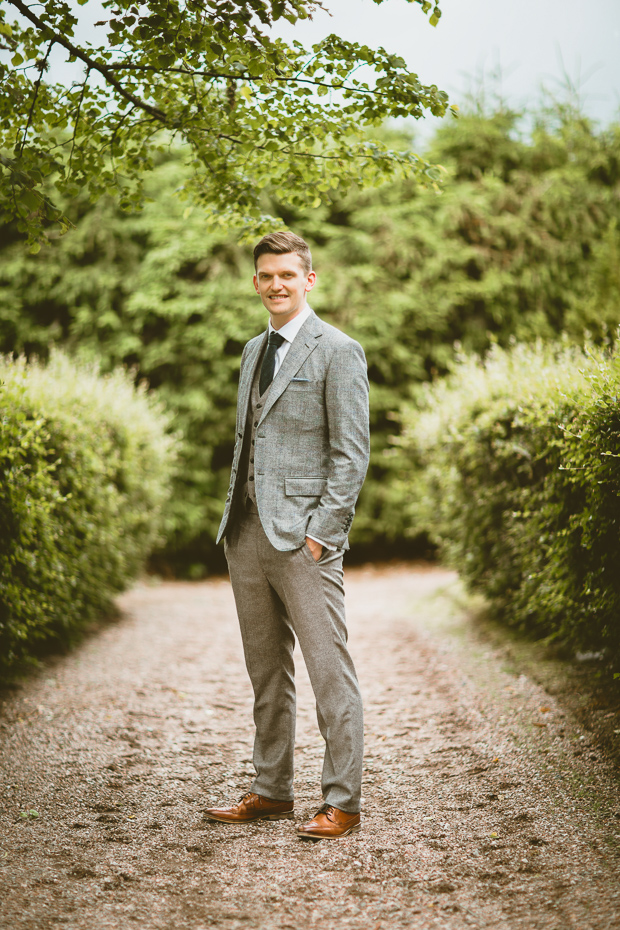The groom was wearing a grey three-piece wedding suit, cognac shoes and a forest green tie