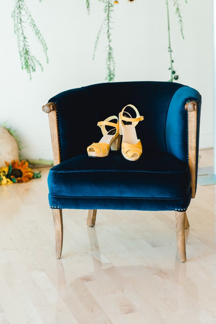 The wedding shoes were yellow ones to match the wedding color scheme