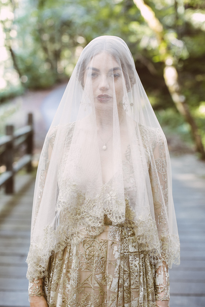 There was a matching gold lace veil to make the bridal look complete