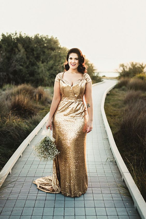 a chic gold sequin wedding gown with cap sleeves and a fluttering cut plus a train for a sparkly look