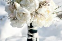 04 a white winter wedding bouquet with white and blush blooms and textural flowers plus a contrasting wrap
