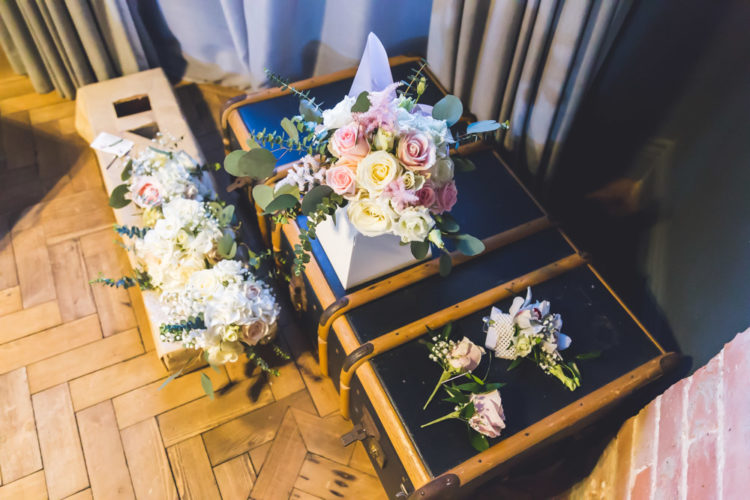 The bouquets were romantic, blush and white blooms plus greenery