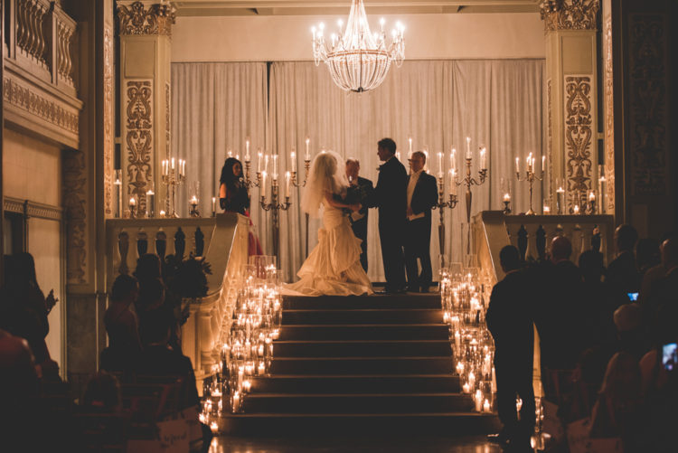 The ceremony was candlelit, with the couple standing up the stairs