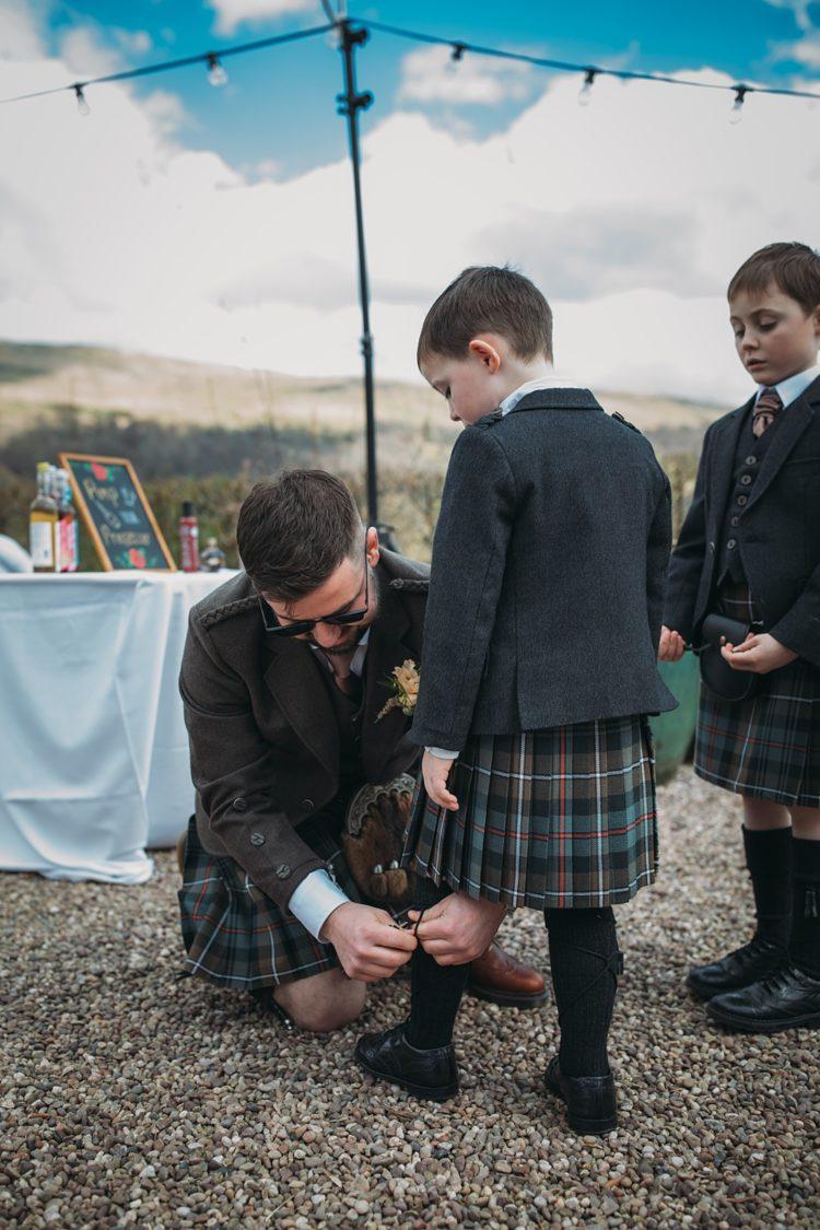 The groom and groomsmen were rocking waistcoats, jackets and kilts