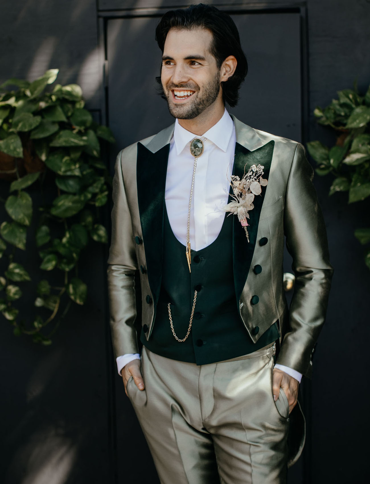 The groom was wearing a green custom made three piece suit with a bejeweled tie