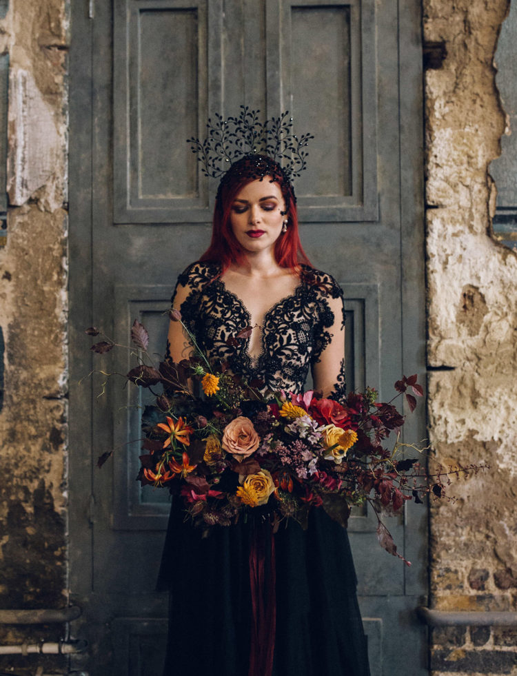 The second bridal look was done with a black princess-style dress, with a black lace bodice and a layered skirt, and look at that headpiece