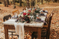 05 The wedding reception was moved to the forest, there were lush florals, an airy table runner, black candles and mismatched chairs