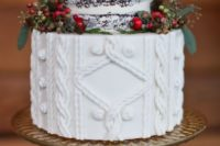 05 a Christmas wedding cake with a naked part and a cable knit one plus berries and little pinecones around