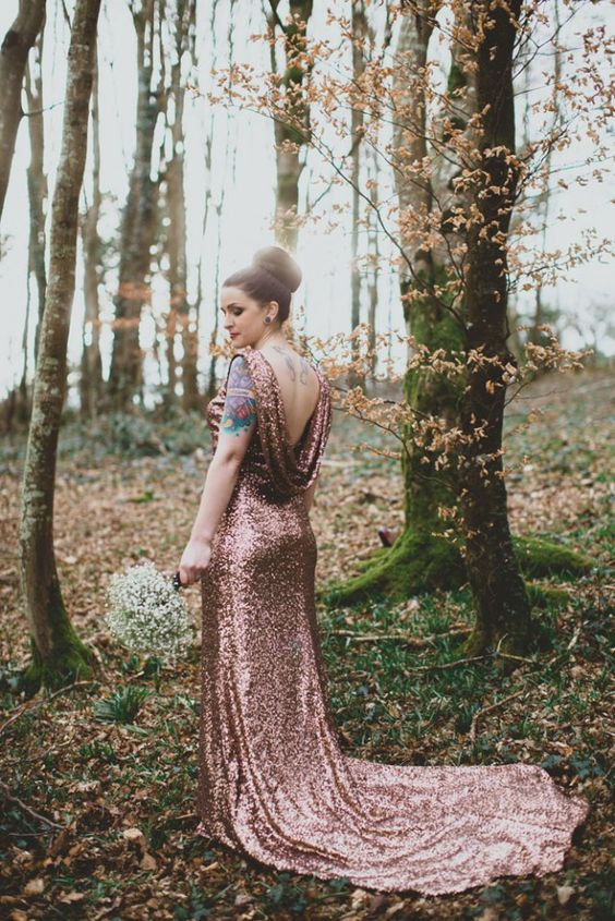 a copper sequin wedding dress with an open back and a train is a great sparkly choice for a New Year's Eve bride