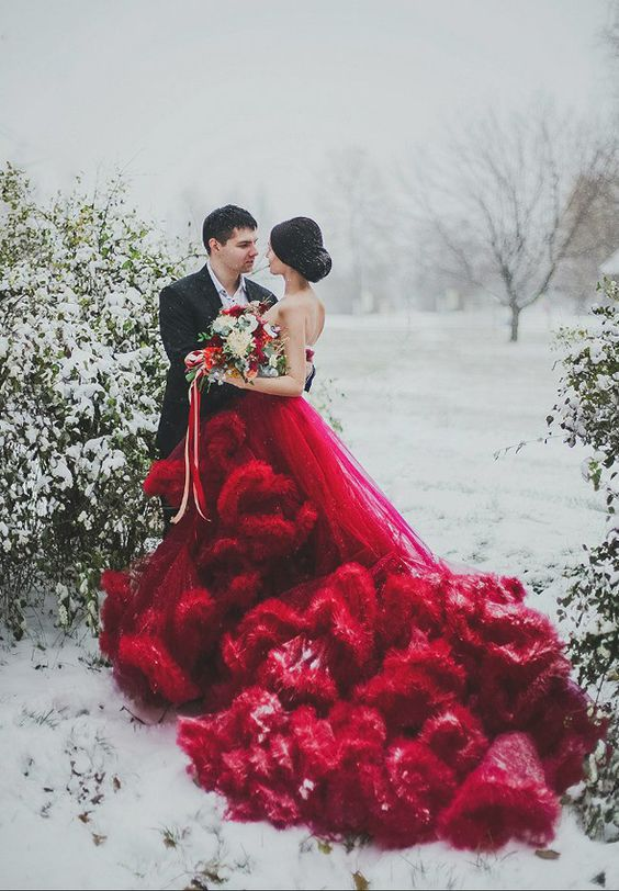 a jaw-dropping red strapless wedding gown with a super ruffled and long train will take everyone's breath away