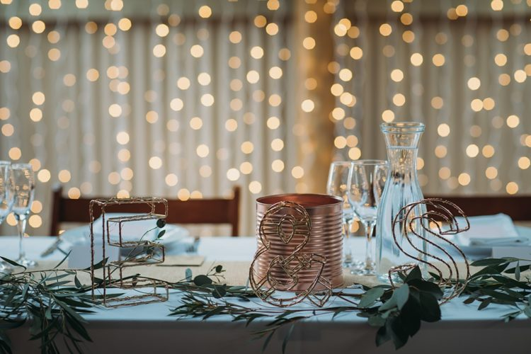 The tables were decorated with greenery, metallic touches, most of them were DIY ones