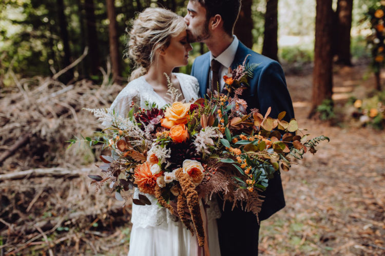 The wedding florals were lush and very rich-colored plus textural