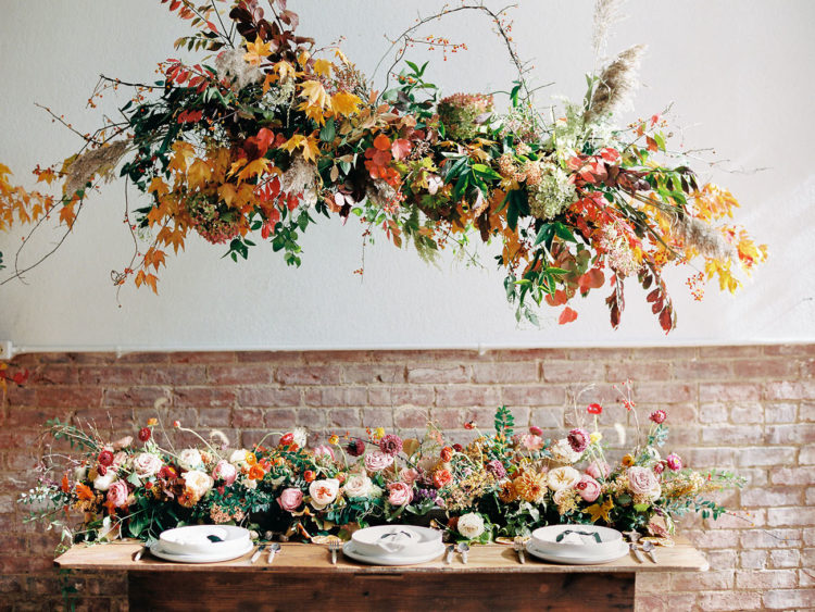 The wedding reception featured a lot of lush and bold florals that brought truly a fall spirit