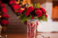 06 a Christmas wedding centerpiece of holly berries, evergreens and red carntions