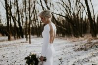 06 a minimalist fitting wedding gown with a high neckline and an open back for a stylish and sexy statement