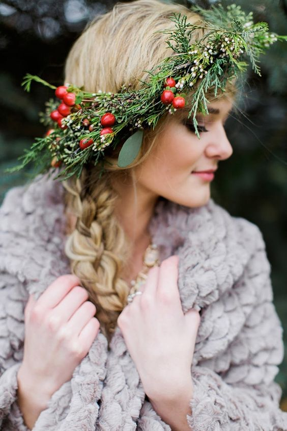 rock a beautiful evergreen and berry wedding crown to give your outfit a traditional Nordic look