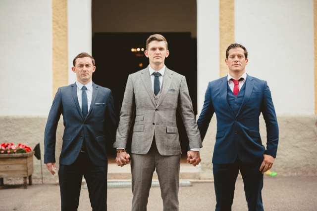 The grooms were wearing mismatching navy suits and ties