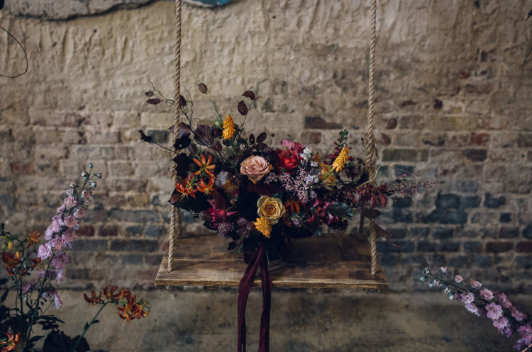 The wedding bouquet was done in autumnal colors, with touches of black and deep purple