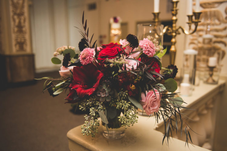The wedding florals were done with dark, red, pink touches and succulents for a moody and sophisticated feel