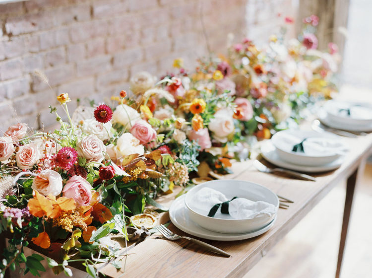 The wedding table runner or centerpiece was done with burnt ornage, magenta, burgundy and playful pink for a bold fall look