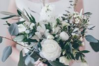 07 a refined and very textural wedding bouquet with foliage and white flowers plus dark ribbons