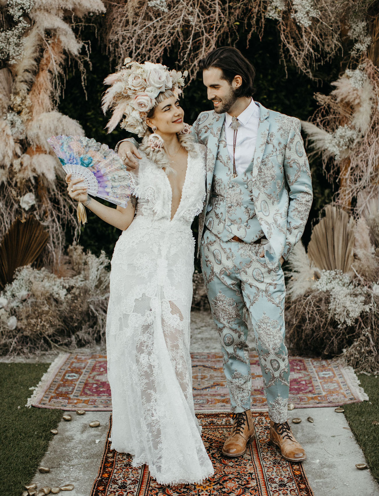 For the reception the bride was wearing a lace plunging neckline wedding gown and the groom was rocking a mint printed three piece suit
