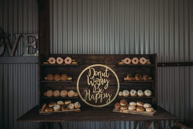 The wedding donut bar is a popular and trendy idea for a wedding, the couple wanted it